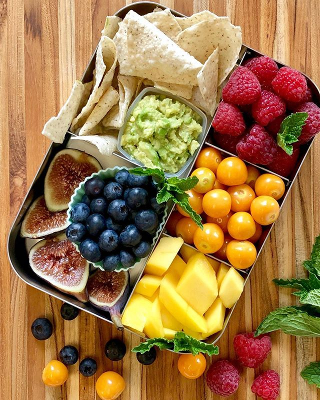 What's at the end of your rainbow? 🌈 • Here's a snack box with nature's rainbow: raspberries, golden berries, mango, guacamole (with chips), blueberries and figs. 🌈 😍 • I was thinking yesterday about how I've become a much better eater since becoming a parent. If I stock the rainbow in the house, I eat the rainbow. 😃 Not always. But much, much more than I did before having kids. 🤷‍♀️ You too? . . . . . . . #rainbowfood #snacksforkids #fruitsalad #healthysnacksforkids #lalalunchbox #lunchboxinspo #veganlunch #healthylunchbox #eattherainbow #healthylunchideas #mypinterest #lunchideas #lunchboxinspo #wastefreelunch #feedfeed #glutenfreesnacks #stpatricksdayfood #snackplatter #berrytogether #thenewhealthy