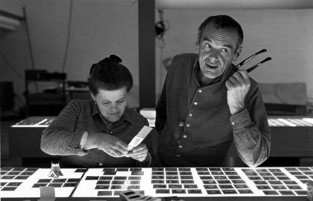 """Ray and Charles Eames select slides for the """"Mathematica"""" exhibition, as seen in EAMES: The Architect and the Painter. Photo: (c) 2011 Eames Office, LLC."""