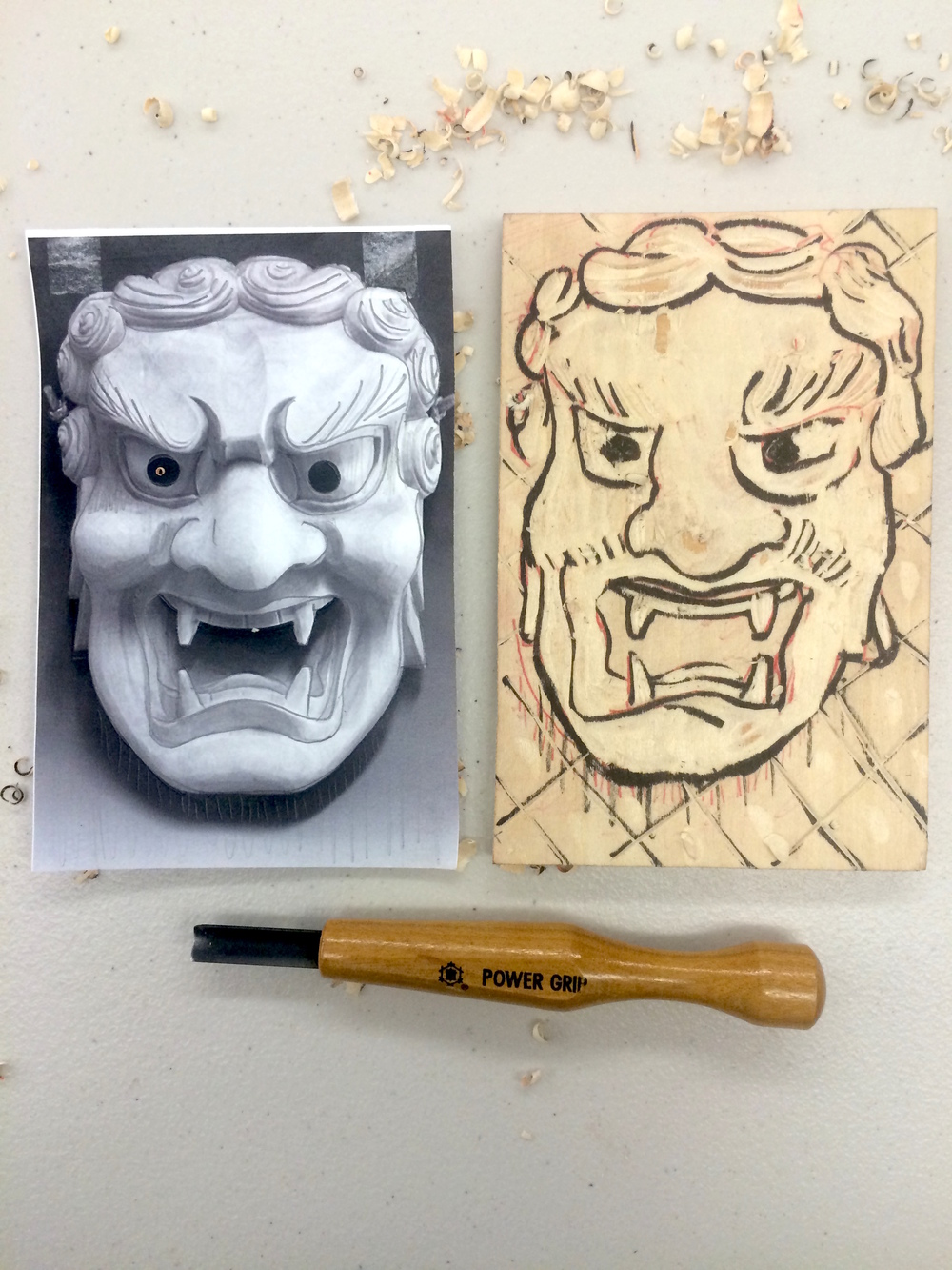 Carving out the image on the woodblock.