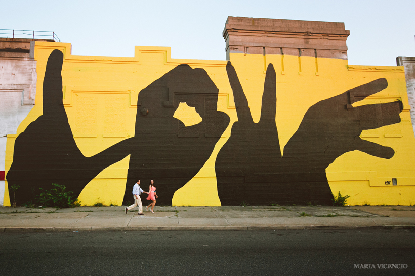 Engaged in front of a Baltimore Love Project mural by Maria Vicencio Photography