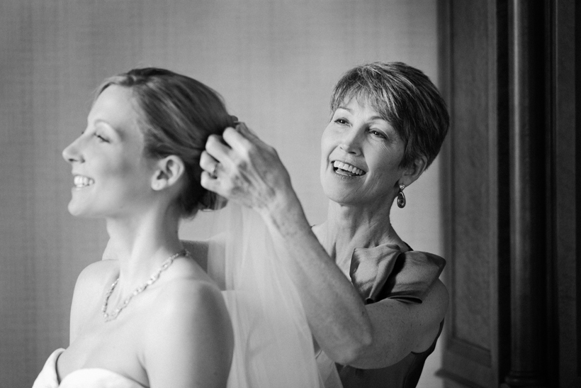 Mother fixing veil by Maria Vicencio Photography