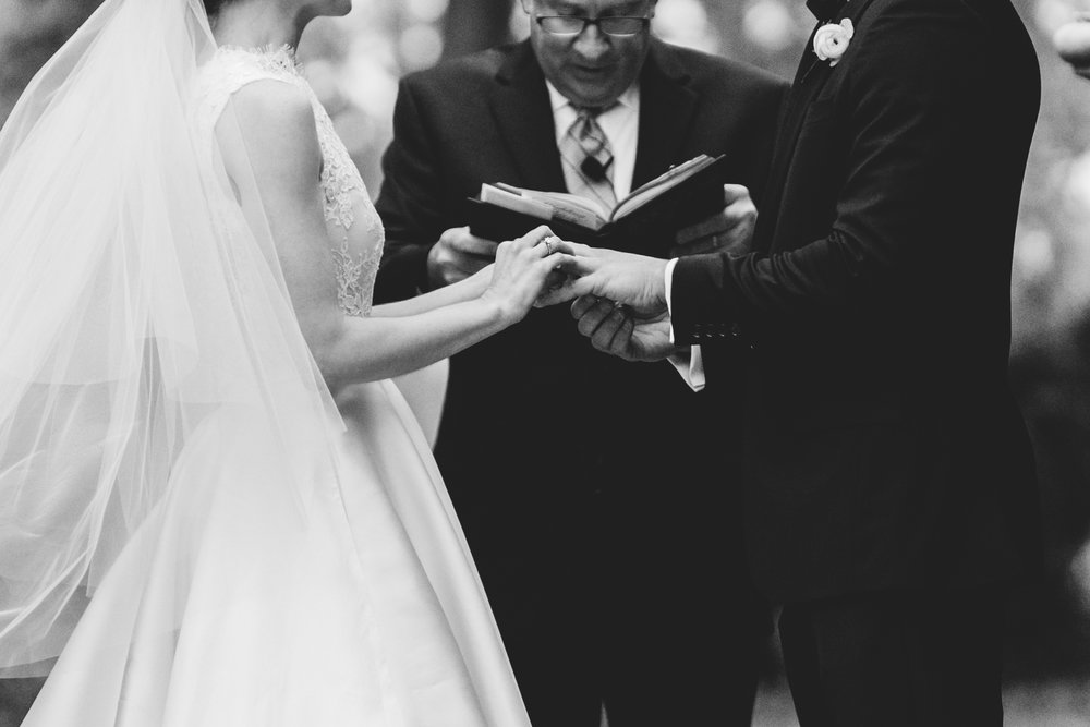 Black and white closeup shot of bride and groom exchanging rings during ceremony at Meridian House in DC - Maria Vicencio Photography Weddings