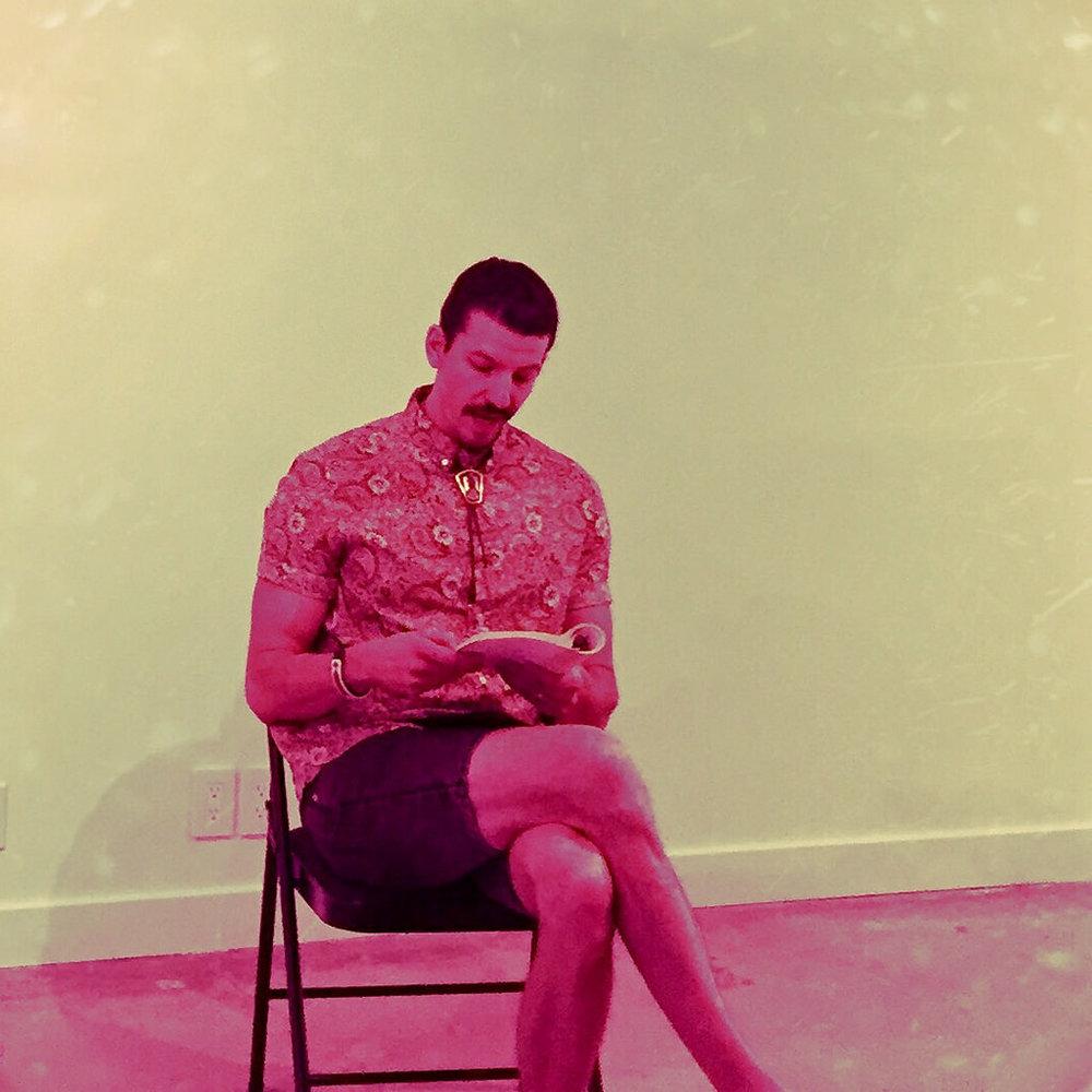 Zachari Logan reading his poetry at Slate Gallery