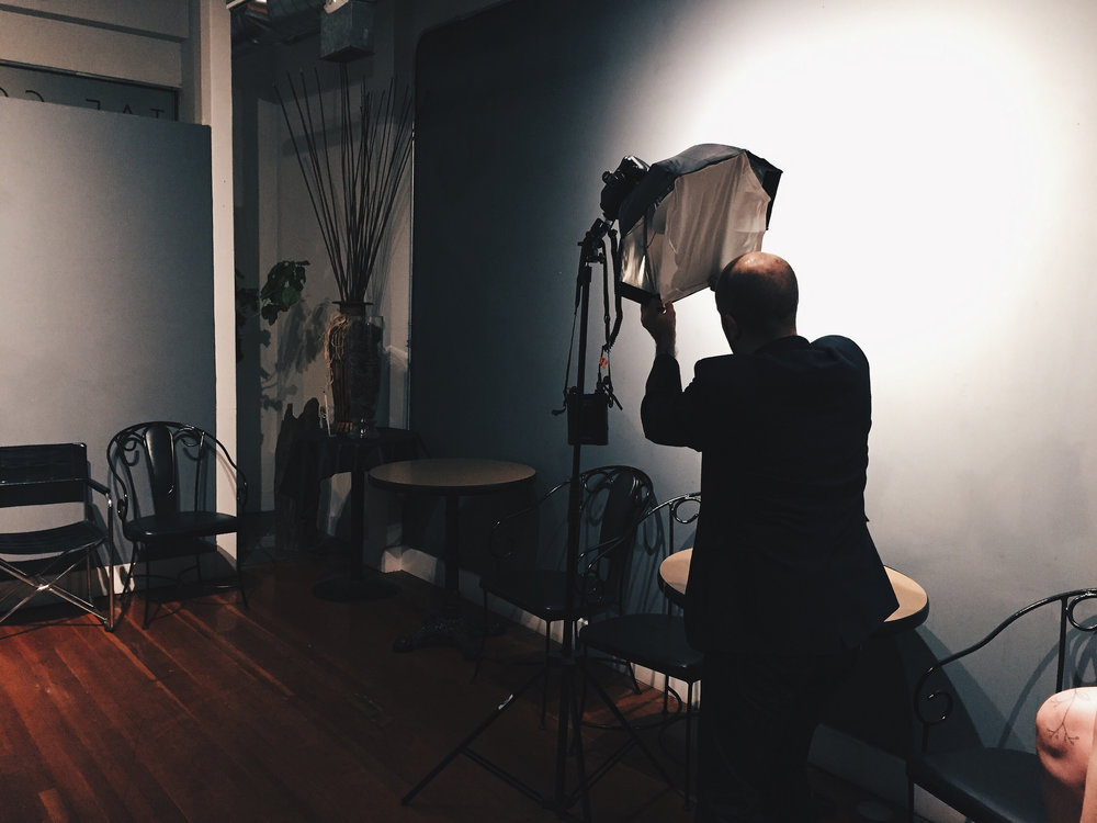 Aidan setting up lighting for a photo shoot for Kindred Cities.