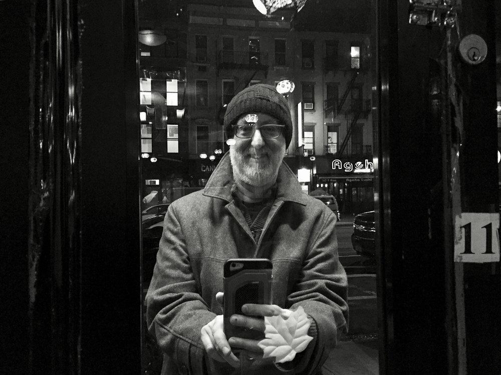 Neil Kramer outside a restaurant window
