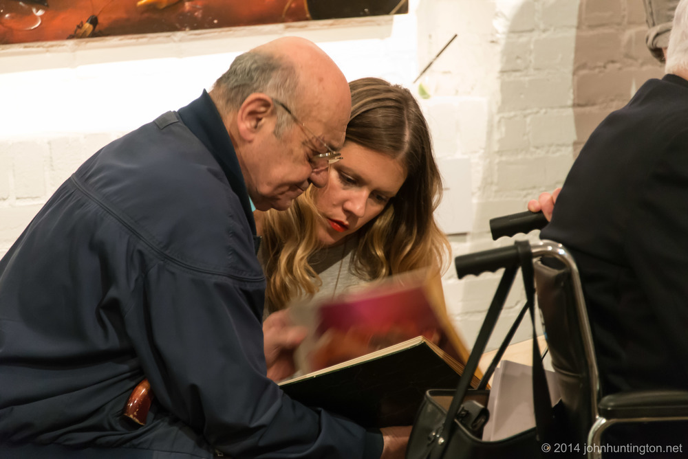Uncle Lou Amber, porn chauffer, showing his scrapbook to Museum of Sex Director of Operations Kelley Cordell
