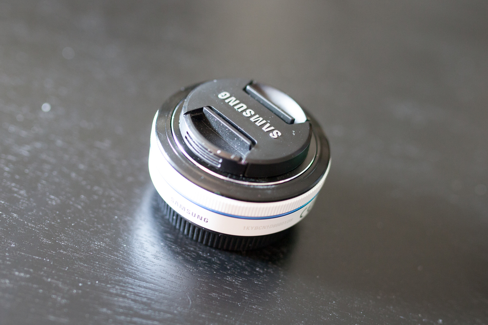 The Samsung 30mm f2.0 Pancake Lens.  And a lot of dust...