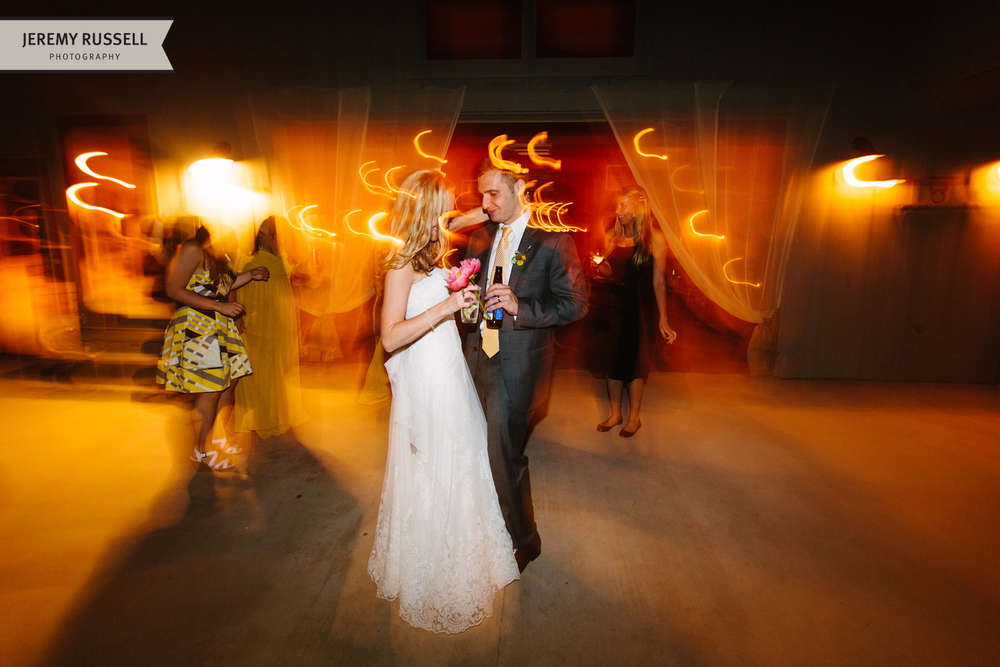 Bride and groom dancing at Claxton Farm