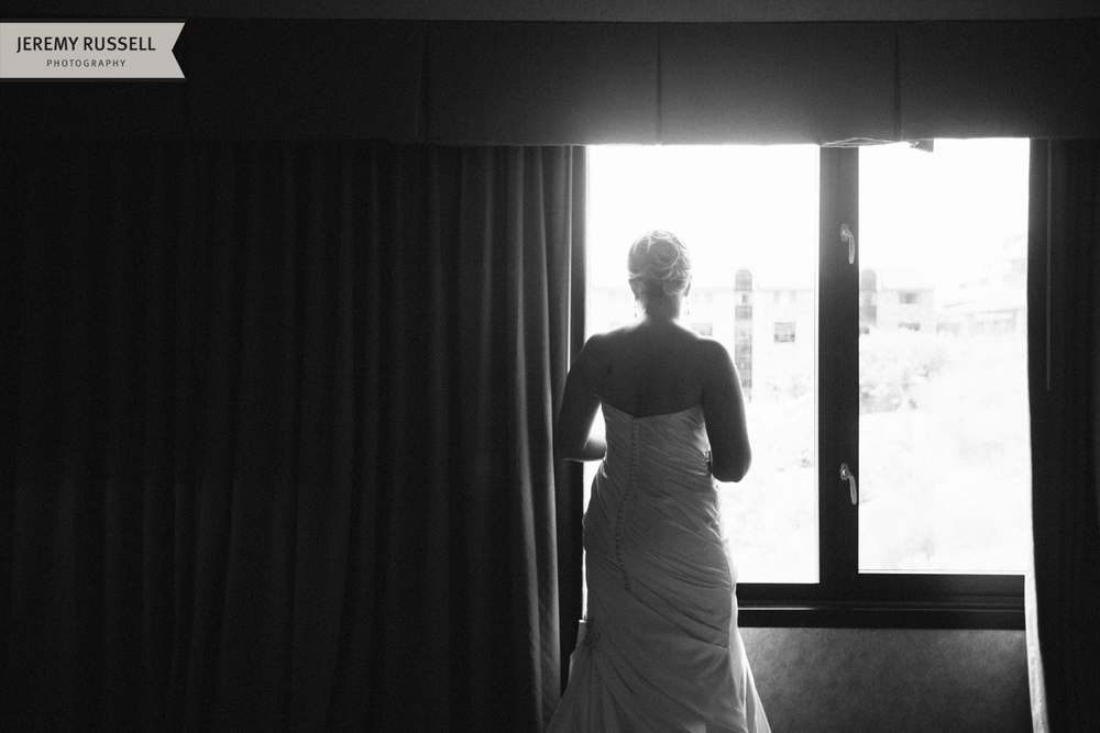 Bride at window. Grove Park Inn, Asheville, NC.
