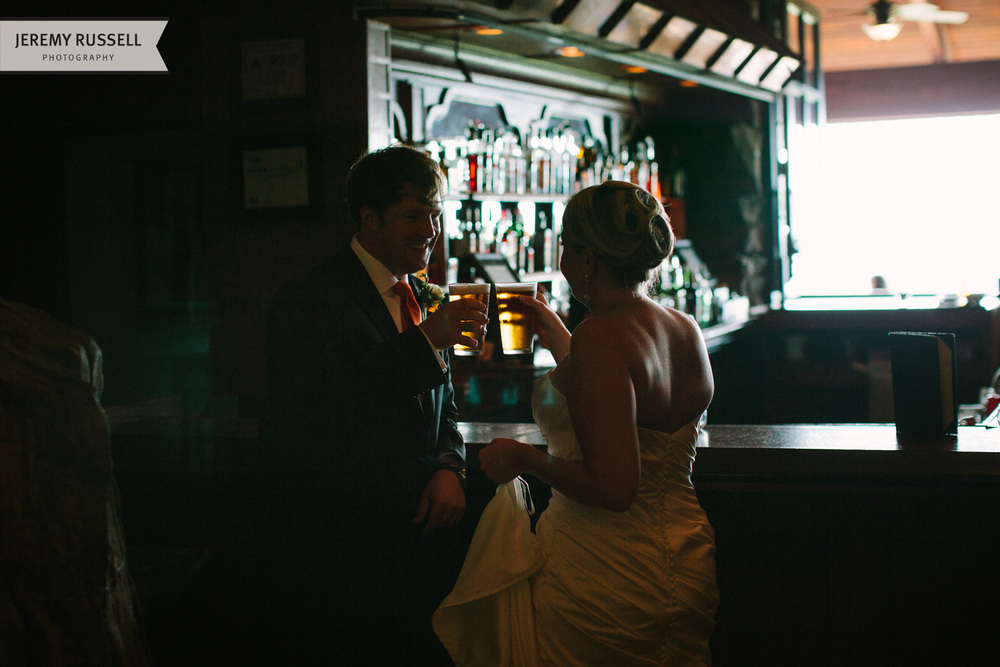 Bride and groom share a beer at Grove Park Inn