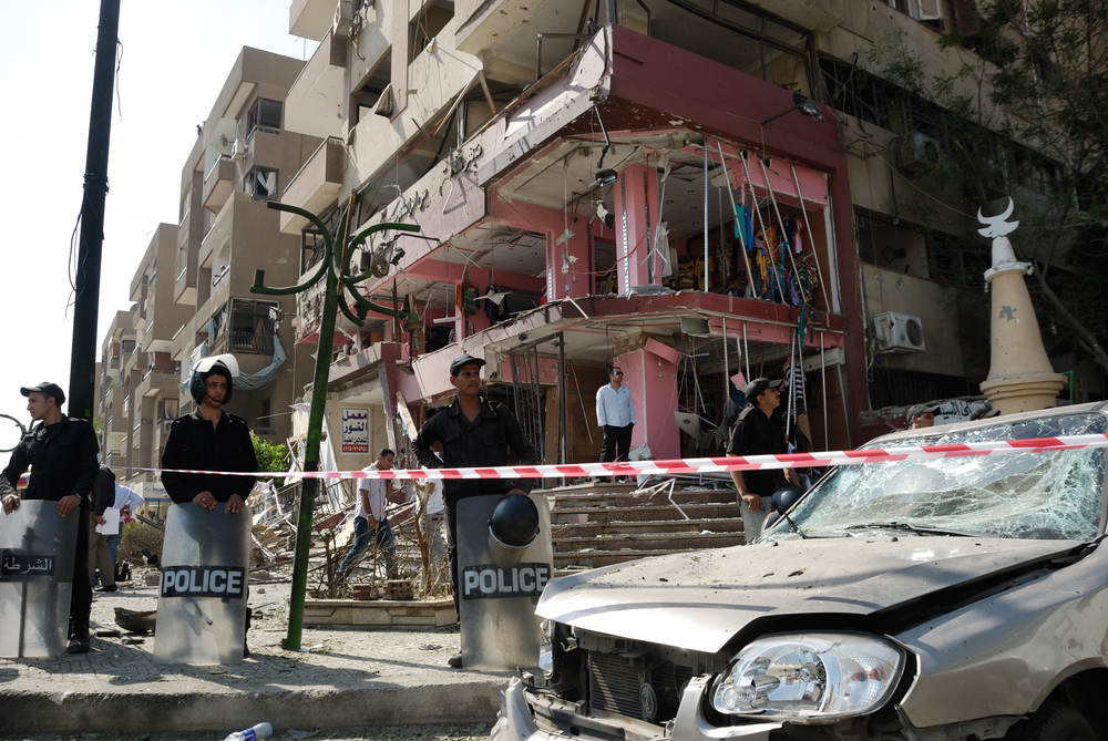 CAIRO - SEP 05: Remains of a big local store at Mostafa Nahas st and neighbors cars after explosion that was targeting the convoy of the Egypt's Interior Minister in Cairo, Egypt on September 05, 2013. Source: Shutterstock.