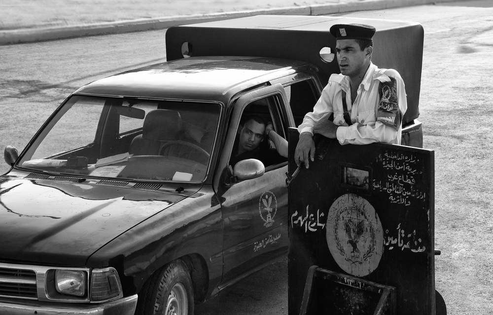 LUXOR, EGYPT - JULY 19, 2010: Egyptian police road check point, On July 19, 2010 Luxor, Egypt. Source: Shutterstock.