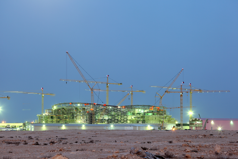 Construction of a new stadium near Lusail in the desert of Qatar. December 16 2013 in Lusail, Qatar.  Philip Lange / Shutterstock.com
