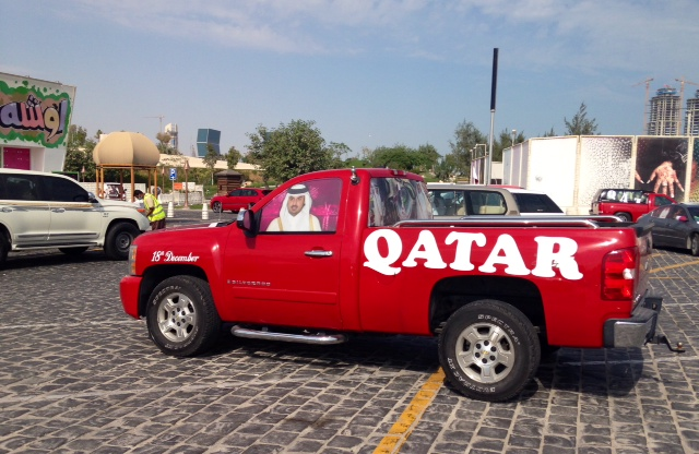 For National Day in Qatar: special paint job and a portrait of Sheikh Tamim on the window.