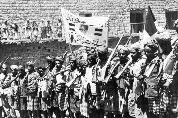 Militiamen mark the overthrow of Imam al-Badr; Sallal is on the banner, 1962 - Sana'a (AP)