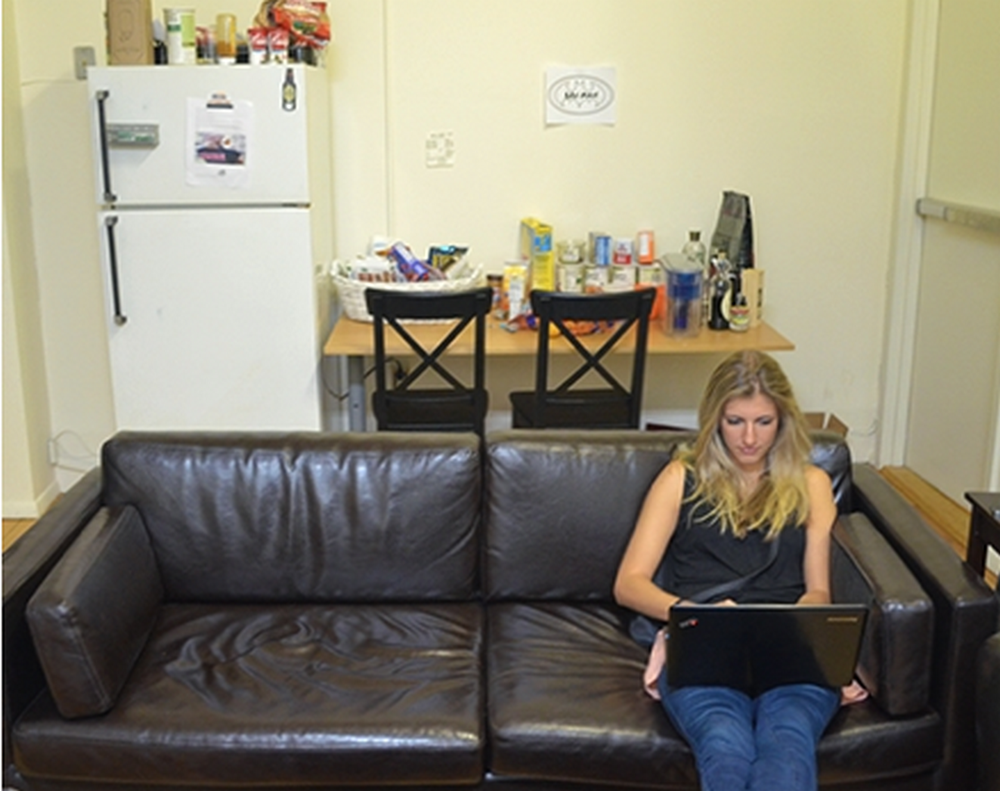 tn_Katie Kapler working on couch.png