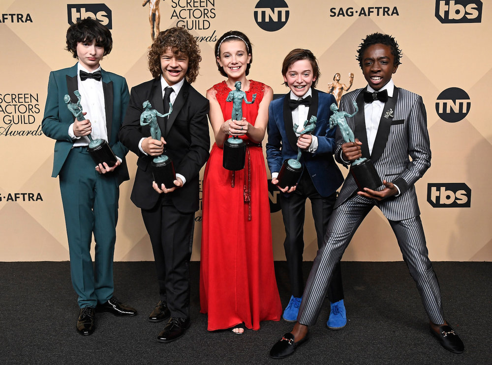 LOS ANGELES, CA - JANUARY 29:  (L-R) Actors Finn Wolfhard, Gaten Matarazzo, Millie Bobby Brown, Noah Schnapp, and Caleb McLaughlin, co-recipients of the Outstanding Performance by an Ensemble in a Drama Series award for 'Stranger Things,' pose in the press room during The 23rd Annual Screen Actors Guild Awards at The Shrine Auditorium on January 29, 2017 in Los Angeles, California. 26592_008  (Photo by Frazer Harrison/Getty Images) *** Local Caption *** Finn Wolfhard;Gaten Matarazzo;Millie Bobby Brown;Noah Schnapp;Caleb McLaughlin