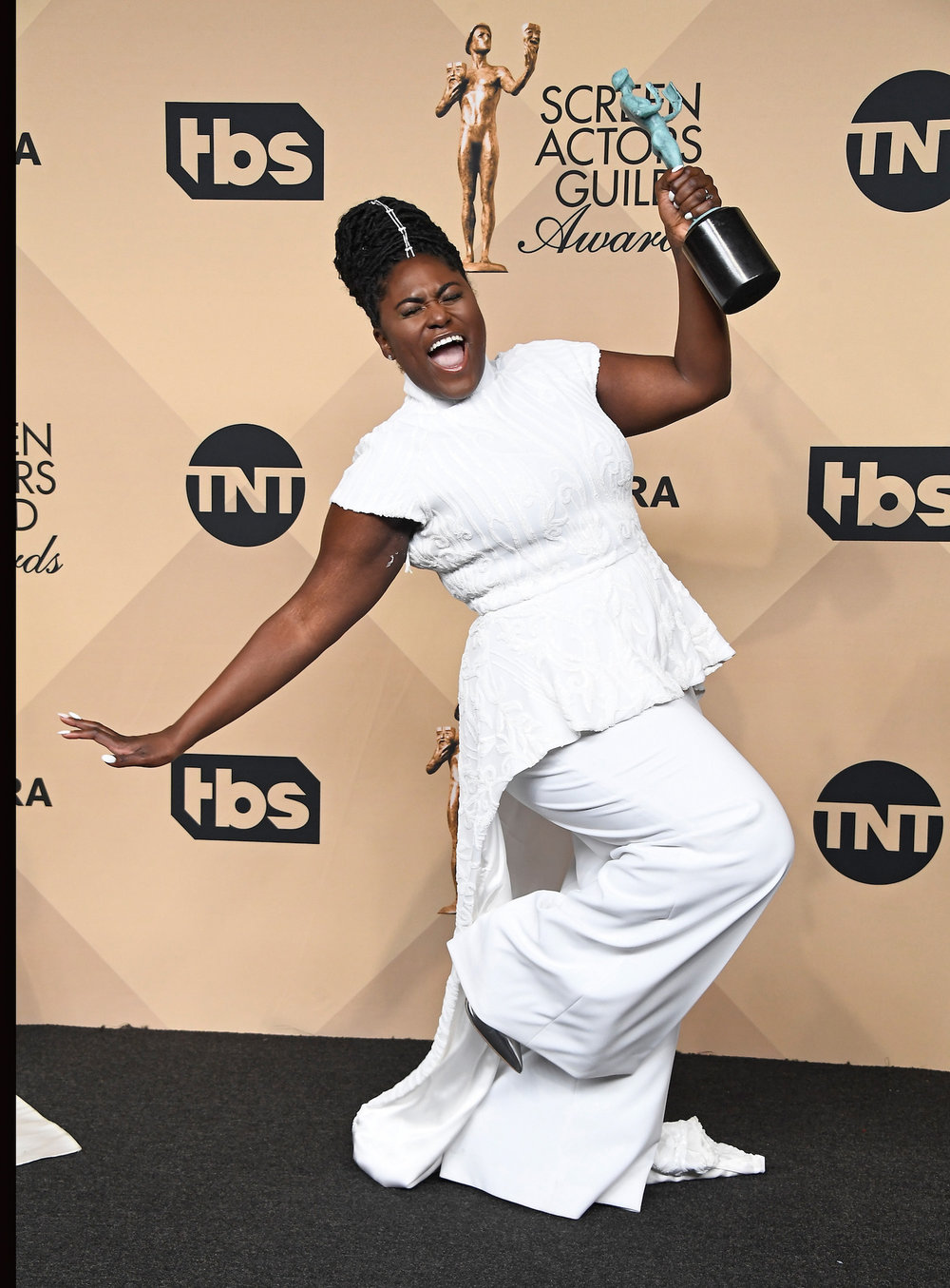 LOS ANGELES, CA - JANUARY 29:  Actor Danielle Brooks, co-winner of the Outstanding Performance by an Ensemble in a Comedy Series award for 'Orange Is the New Black,' poses in the press room during The 23rd Annual Screen Actors Guild Awards at The Shrine Auditorium on January 29, 2017 in Los Angeles, California. 26592_008  (Photo by Frazer Harrison/Getty Images) *** Local Caption *** Danielle Brooks