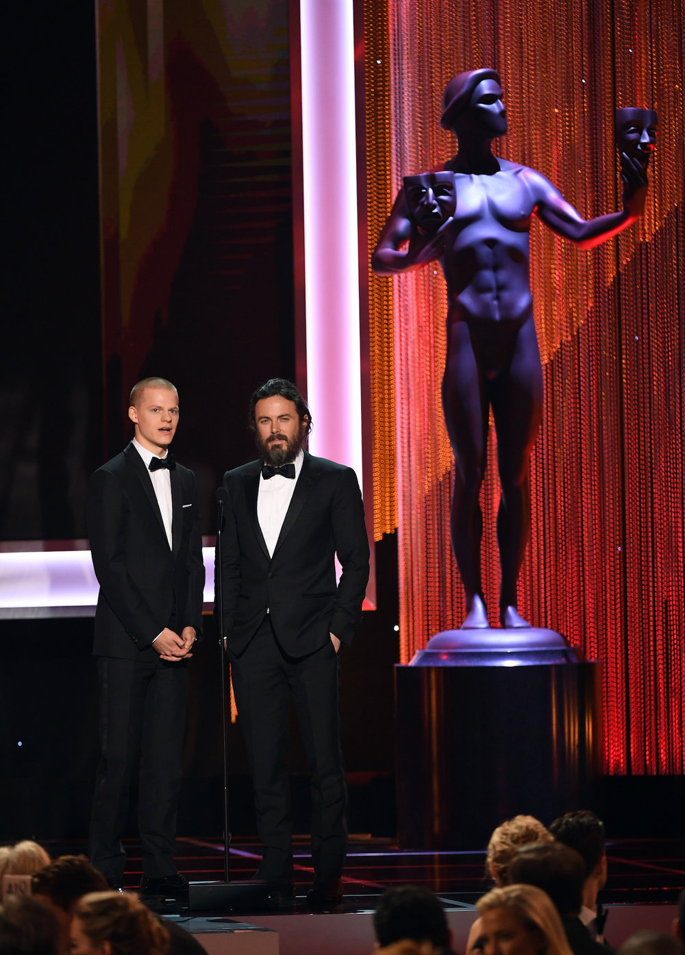 LOS ANGELES, CA - JANUARY 29:  Actors Lucas Hedges (L) and Casey Affleck speak onstage during The 23rd Annual Screen Actors Guild Awards at The Shrine Auditorium on January 29, 2017 in Los Angeles, California. 26592_014  (Photo by Kevin Winter/Getty Images ) *** Local Caption *** Lucas Hedges, Casey Affleck