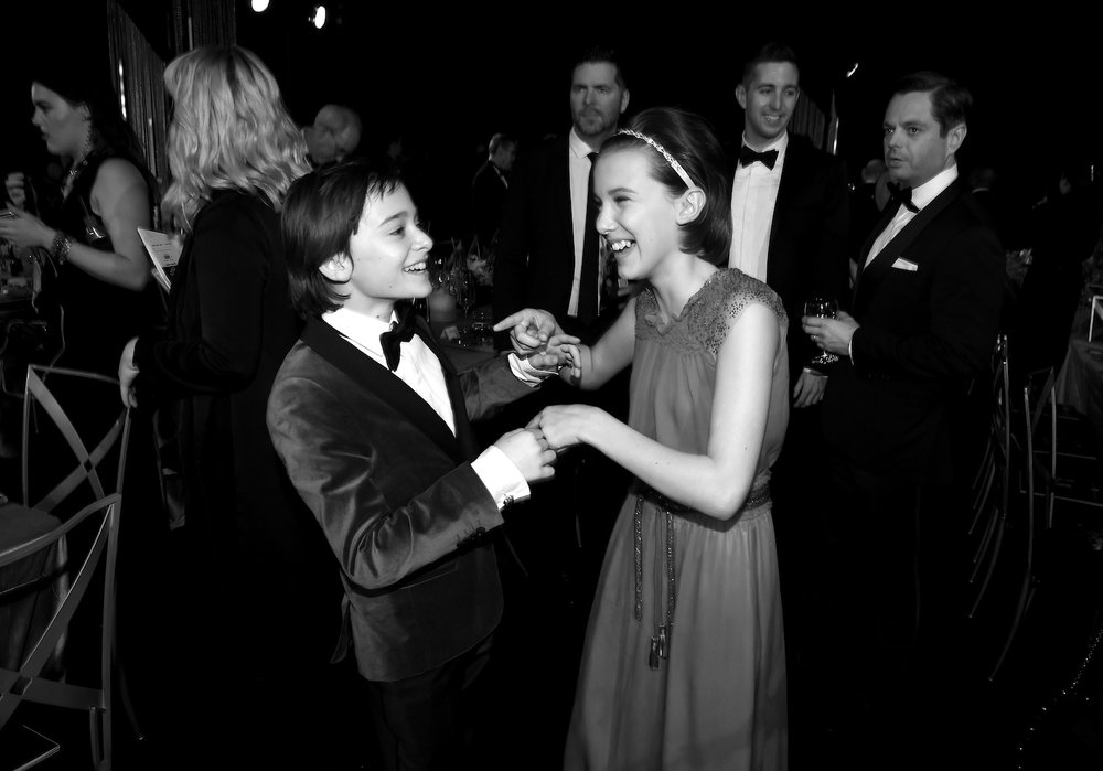 LOS ANGELES, CA - JANUARY 29:  Actors Noah Schnapp (L) and Millie Bobby Brown attend The 23rd Annual Screen Actors Guild Awards Cocktail Reception at The Shrine Auditorium on January 29, 2017 in Los Angeles, California. 26592_014  (Photo by Kevin Winter/Getty Images for TNT) *** Local Caption *** Noah Schnapp;Millie Bobby Brown