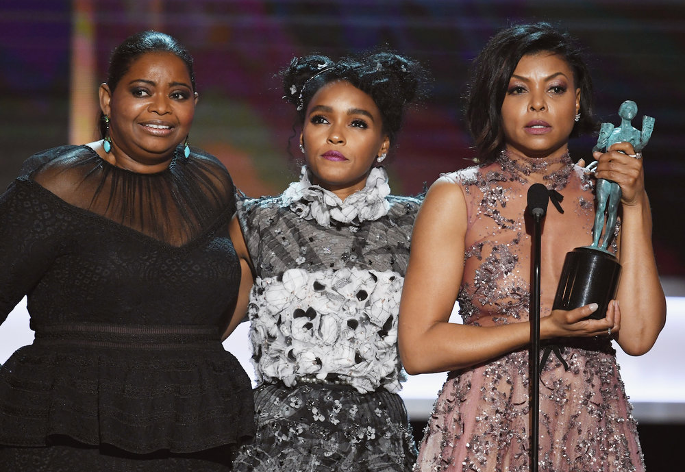 LOS ANGELES, CA - JANUARY 29:  (L-R) Actors Octavia Spencer, Janelle Monae and Taraji P. Henson accept Outstanding Performance by a Cast in a Motion Picture for 'Hidden Figures' onstage during The 23rd Annual Screen Actors Guild Awards at The Shrine Auditorium on January 29, 2017 in Los Angeles, California. 26592_014  (Photo by Kevin Winter/Getty Images ) *** Local Caption *** Octavia Spencer, Janelle Monae;Taraji P. Henson