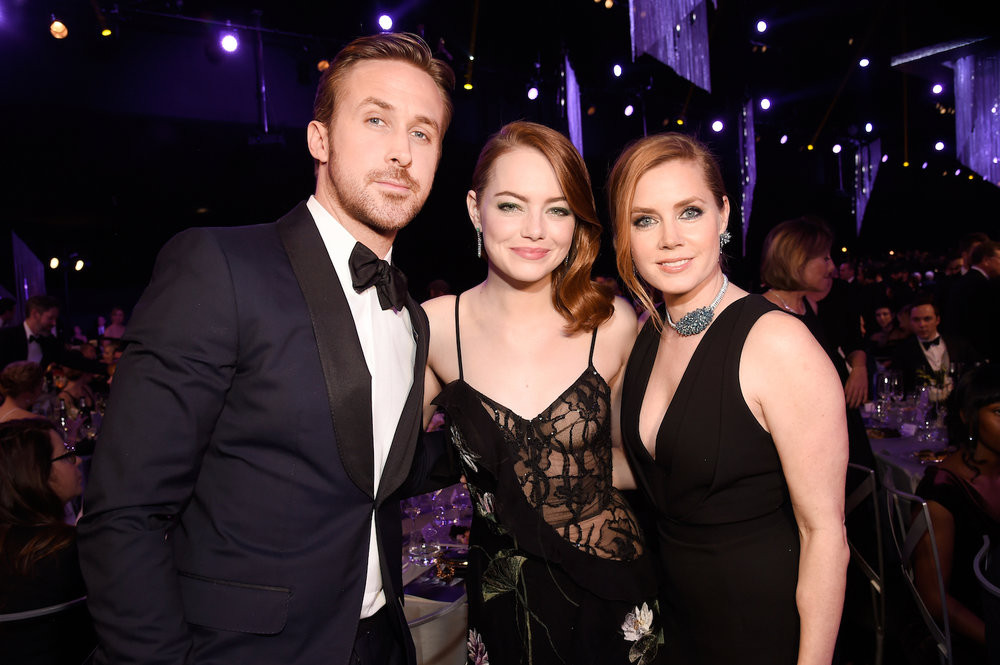 LOS ANGELES, CA - JANUARY 29:  (L-R) Actors Ryan Gosling, Emma Stone and Amy Adams pose during The 23rd Annual Screen Actors Guild Awards at The Shrine Auditorium on January 29, 2017 in Los Angeles, California. 26592_011  (Photo by Kevin Mazur/Getty Images for TNT) *** Local Caption *** Ryan Gosling;Emma Stone;Amy Adams