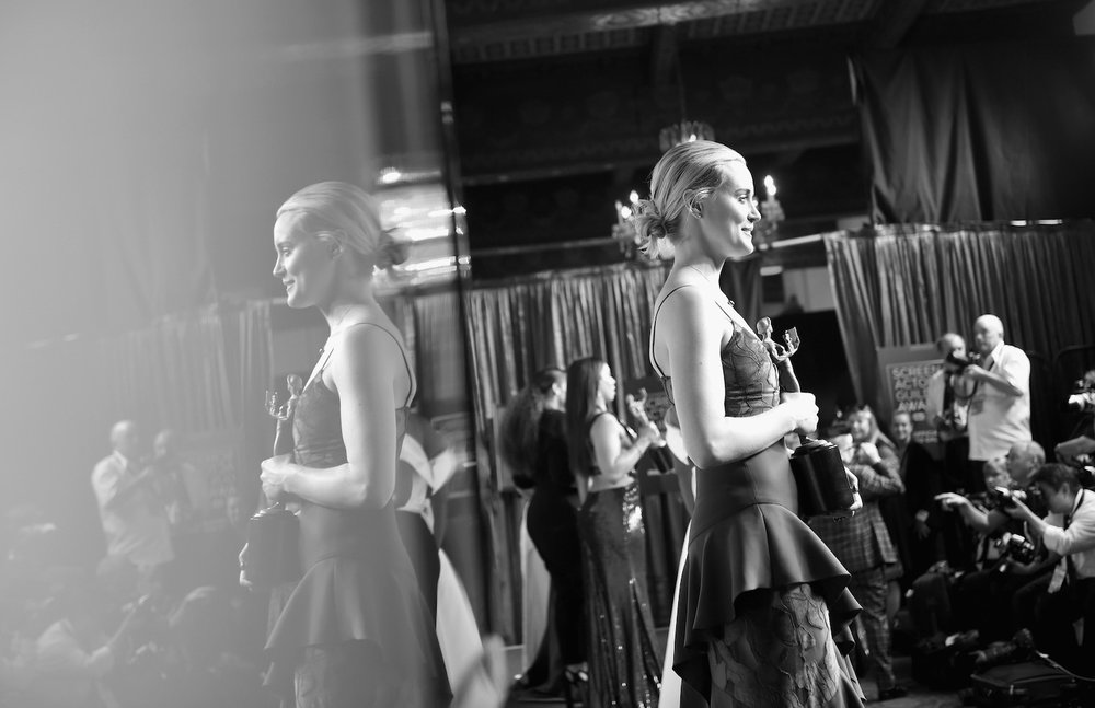 LOS ANGELES, CA - JANUARY 29:  (EDITORS NOTE: Image has been converted to black and white.) Actor Taylor Schilling poses with an award during The 23rd Annual Screen Actors Guild Awards at The Shrine Auditorium on January 29, 2017 in Los Angeles, California. 26592_016  (Photo by Emma McIntyre/Getty Images for TNT) *** Local Caption *** Taylor Schilling