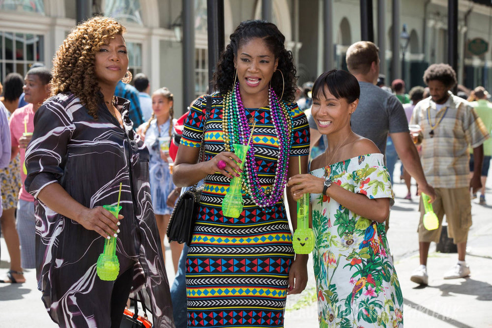 "In ""Girls Trip,"" when four lifelong friends—(L to R) Sasha (QUEEN LATIFAH), Dina (TIFFANY HADDISH), Lisa (JADA PINKETT SMITH) and Ryan (REGINA HALL, not pictured)—travel to New Orleans for the annual ""Essence"" Festival, sisterhoods are rekindled, wild sides are rediscovered, and there's enough dancing, drinking, brawling and romancing to make the Big Easy blush."