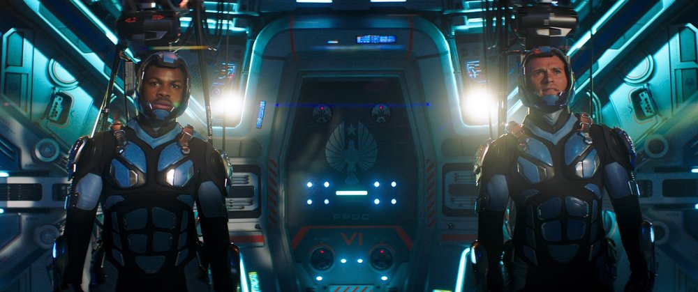 "(L to R, foreground) JOHN BOYEGA as Jake and SCOTT EASTWOOD as Lambert in the ""Gipsy Avenger"" conn pod in ""Pacific Rim Uprising.""  The globe-spanning conflict between otherworldly monsters of mass destruction and the human-piloted super-machines built to vanquish them was only a prelude to the all-out assault on humanity."