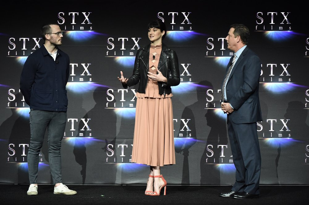 Sam Claflin, Shailene Woodley and Adam Fogelson speak during STXfilms' 2018 CinemaCon Presentation at The Colosseum of Caesars Palace, Las Vegas, NV Tuesday, April 24, 2018.
