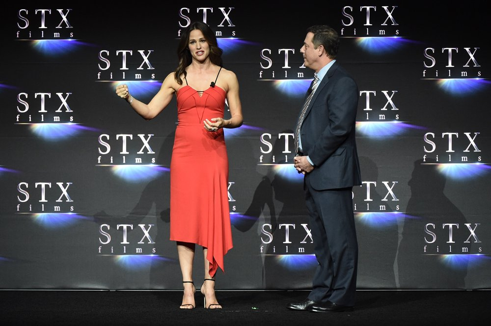 Jennifer Garner and Adam Fogelson speak during STXfilms' 2018 CinemaCon Presentation at The Colosseum of Caesars Palace, Las Vegas, NV Tuesday, April 24, 2018.