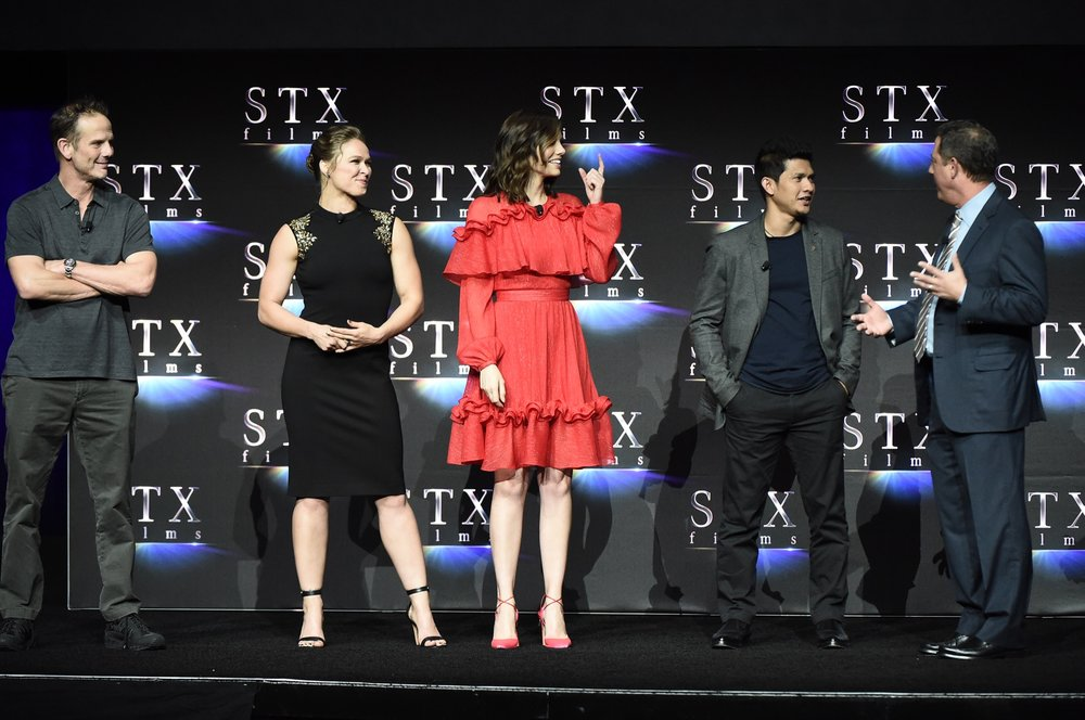 Director Peter Berg, Ronda Rousey, Lauren Cohan, Iko Uwais and Adam Fogelson speak during STXfilms' 2018 CinemaCon Presentation at The Colosseum of Caesars Palace, Las Vegas, NV Tuesday, April 24, 2018.