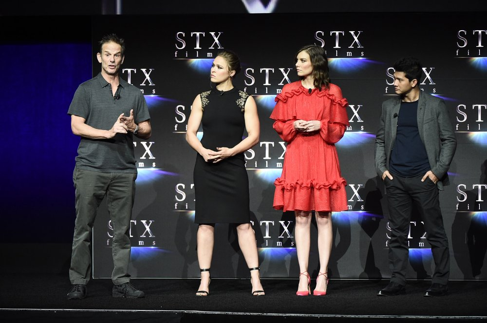 Director Peter Berg, Ronda Rousey, Lauren Cohan and Iko Uwais speak during STXfilms' 2018 CinemaCon Presentation at The Colosseum of Caesars Palace, Las Vegas, NV Tuesday, April 24, 2018.