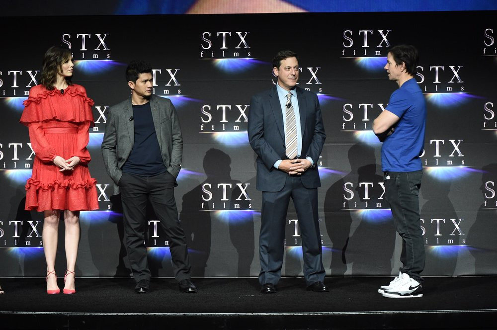 Lauren Cohan, Iko Uwais, Adam Fogelson and Mark Wahlberg speak during STXfilms' 2018 CinemaCon Presentation at The Colosseum of Caesars Palace, Las Vegas, NV Tuesday, April 24, 2018.