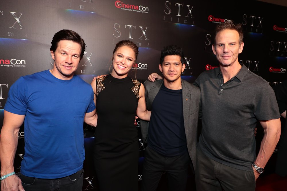 Mark Wahlberg, Ronda Rousey, Iko Uwais and Director Peter Berg attend STXfilms' 2018 CinemaCon Presentation at The Colosseum of Caesars Palace, Las Vegas, NV Tuesday, April 24, 2018.
