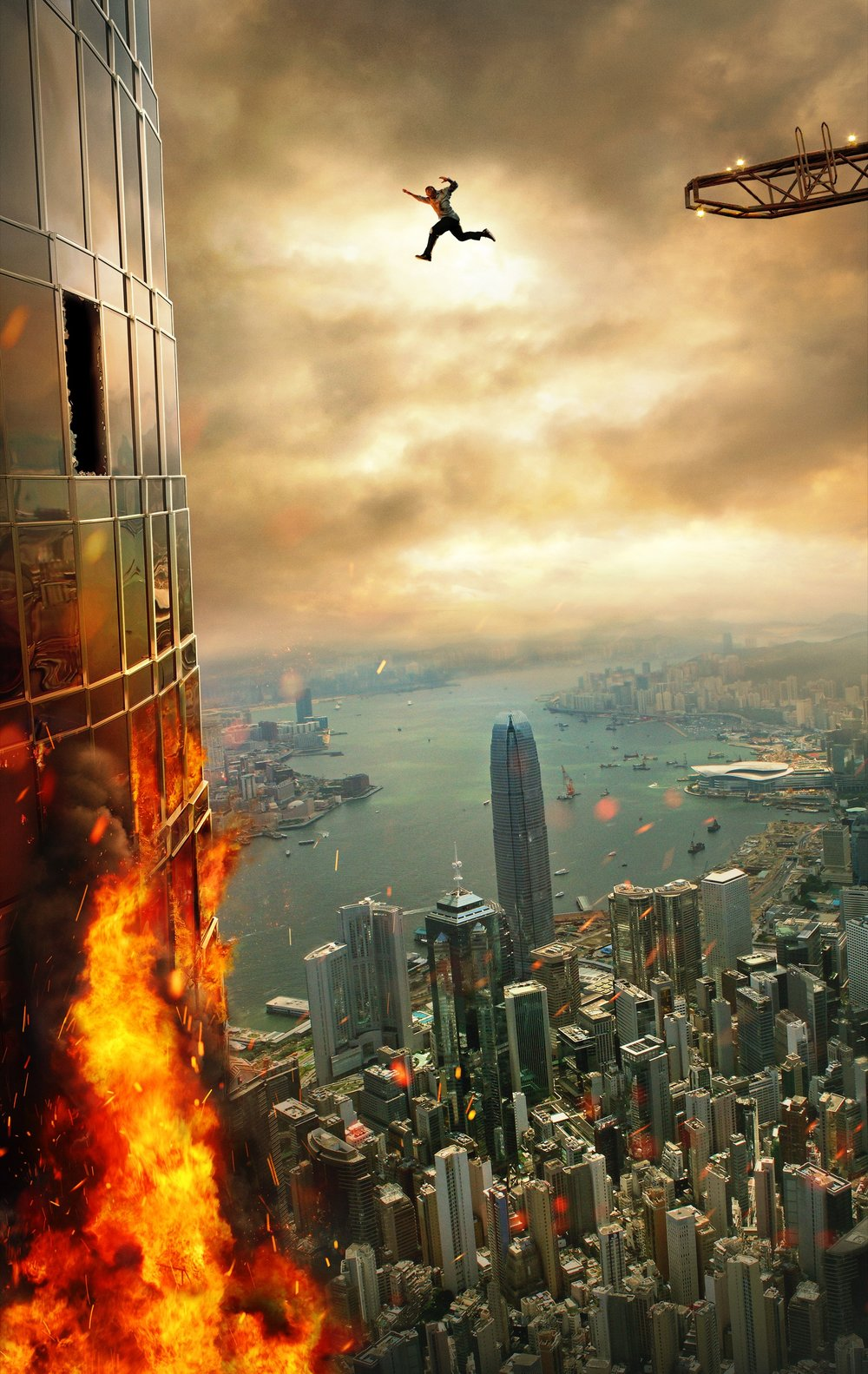 """Global icon DWAYNE JOHNSON leads the cast of Legendary's """"Skyscraper"""" as former FBI Hostage Rescue Team leader and U.S. war veteran Will Sawyer, who now assesses security for skyscrapers.  On assignment in China he finds the tallest, safest building in the world suddenly ablaze, and he's been framed for it.  A wanted man on the run, Will must find those responsible, clear his name and somehow rescue his family who is trapped inside the building...above the fire line."""