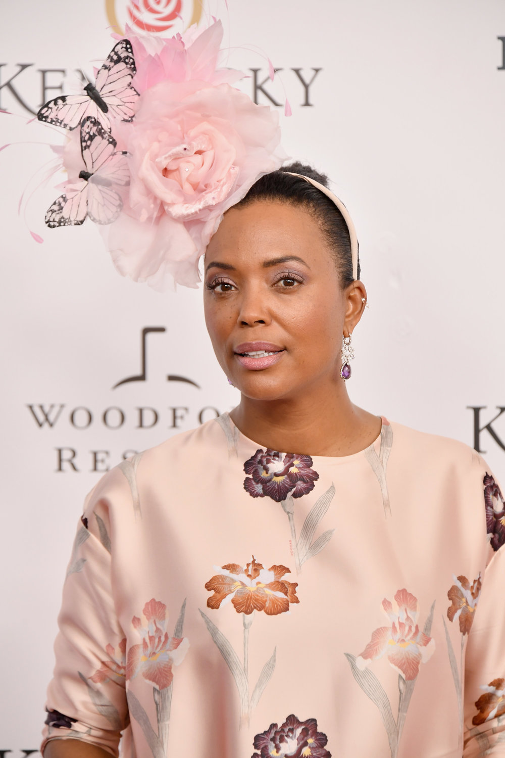 LOUISVILLE, KY - MAY 05: Actress Aisha Tyler attends Kentucky Derby 144 on May 5, 2018 in Louisville, Kentucky.  (Photo by Michael Loccisano/Getty Images for Churchill Downs) *** Local Caption *** Aisha Tyler