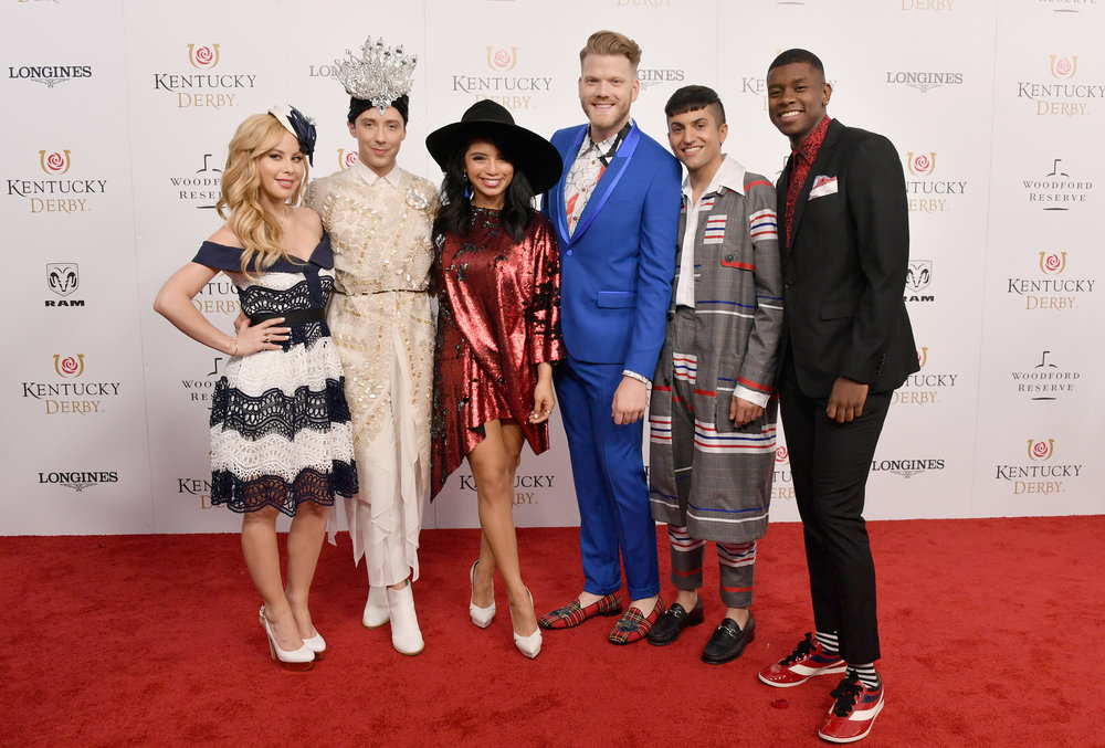 LOUISVILLE, KY - MAY 05:  Figure skaters Tara Lipinski and Johnny Weir and Kirstin Maldonado, Scott Hoying, Mitch Grassi, and Kevin Olusola of the a cappella group Pentatonix attend Kentucky Derby 144 on May 5, 2018 in Louisville, Kentucky.  (Photo by Michael Loccisano/Getty Images for Churchill Downs) *** Local Caption *** Kirstin Maldonado;Scott Hoying;Mitch Grassi;Kevin Olusola;Johnny Weir;Tara Lipinski
