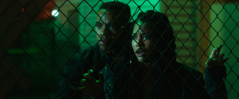"Isaiah (JOIVAN WADE) and Nya (LEX SCOTT DAVIS) in ""The First Purge."" Behind every tradition lies a revolution. This Independence Day, witness the rise of our country's 12 hours of annual lawlessness. Welcome to the movement that began as a simple experiment: ""The First Purge."""