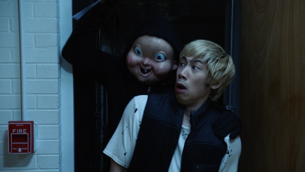 "Ryan (Phi Vu) under attack from ""Babyface"" in ""Happy Death Day 2U,"" written and directed by Christopher Landon."