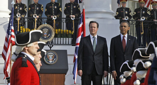 NO JOKE: Cameron 'tucked in bed' by Obama during trip...