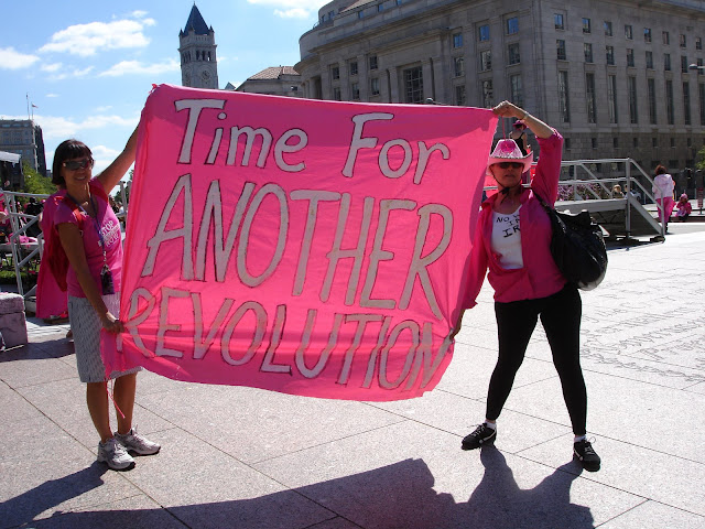 """First lady tells Code Pink: 'Keep up the great work'... Michelle squeezed her hand and said, """"We really need you""""..."""