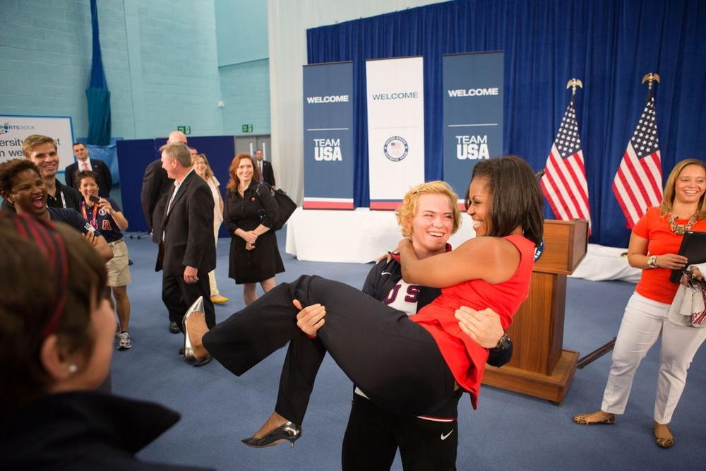 Photo of the Day: At the  # London2012    # Olympics  , the First Lady gets a lift from US wrestler Elena Pirozhkova: pic.twitter.com/5fMtTsgM