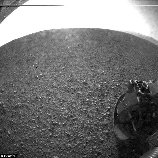 About two hours after landing on Mars and beaming back its first image, NASA's Curiosity rover transmitted a higher-resolution image of its new Martian home without the mysterious shape on the horizon...