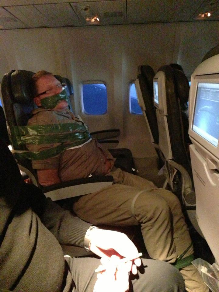 Restrained Passenger On IcelandAir Flight (credit: andyellwood.tubmblr.com)
