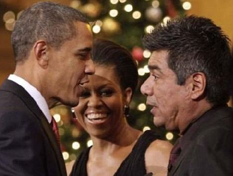 President Obama meeting comedian George Lopez as the First Lady looks on. Some observers believe this image shows a distinctive scar which looks like those left after brain surgery. However, there could simply be another explanation such as a bad haircut or birth mark