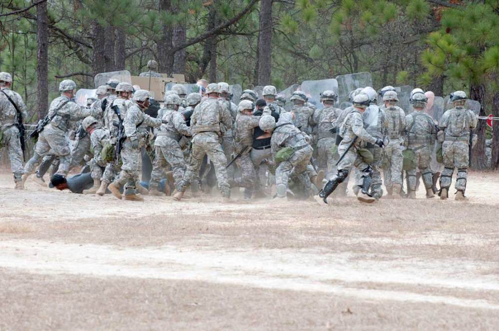 """Soldiers from the 3rd Battalion, 321st Field Artillery Regiment, XVIII Fires Brigade train last December to """"respond to an escalating civil-disturbance situation caused by unhappy simulated hurricane victims."""" According to an article produced by the 82nd Combat Aviation Brigade, the training was designed to prepare the soldiers """"for their upcoming assignment as a quick reaction and rapid response force for U.S. Army North Command in support of emergencies in the United States."""""""