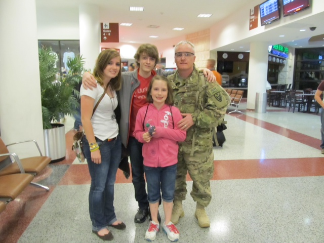 Master Sgt. CJ Grisham with his children on the day he returned from Afghanistan.