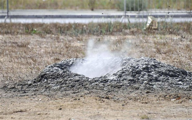 Italian experts have been puzzled by the overnight appearance of a geyser crater spraying clouds of gas 15 feet in the air, yards from the end of the runway at one of Europe's busiest airports.