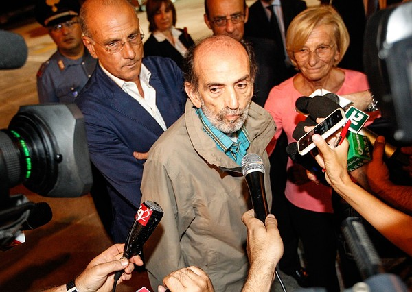 Italian journalist Domenico Quirico (C), who was kidnapped in Syria in early April, answers to journalists after disembark from the airplane on September 9, 2013 at Ciampino military airport in Rome. Credit: AFP/Getty Images